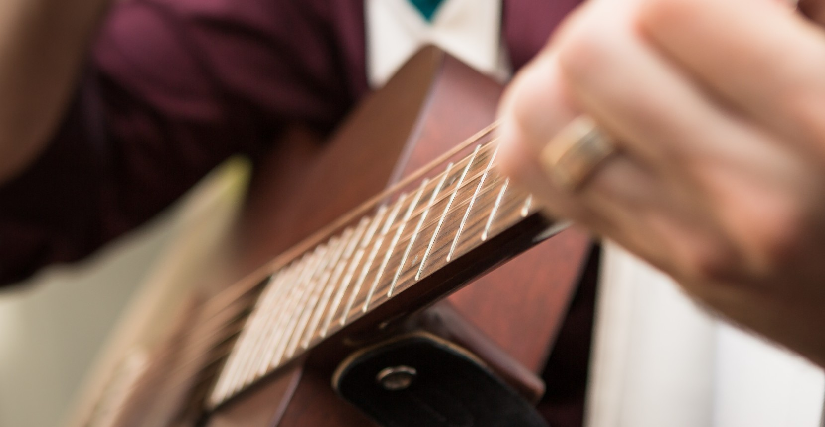 Cantor Michael Smolash playing guitar