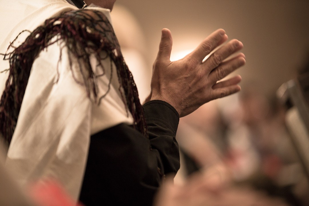 Hands clasped together in prayer