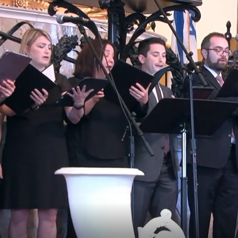 ACC members singing in an ensemble for the concert